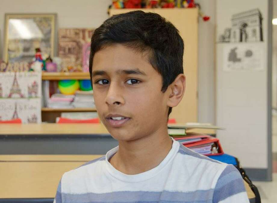 Arshaq Ahmed, who came in third in his category at the national level of the invention convention earlier this year, is pondering his next invention. Photo: Jill Dion
