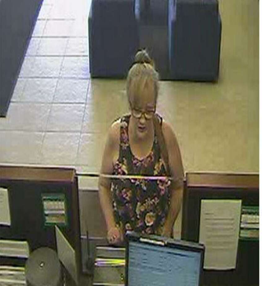 Police say this woman, identified by police as Roberta Leach, 58, of Waterbury, illegally cashed a fake $6,800 check in Southbury that was drawn on the account of a 92-year-old Stamford woman. Photo: Stamford Police / Contributed