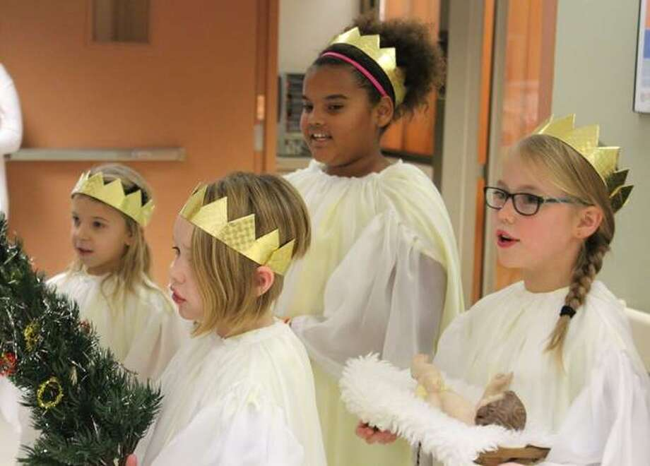 """Four local """"angels"""" shared a message of inspiration and hope with patients at OSF Saint Anthony's and at Saint Clare's Villa earlier this month."""