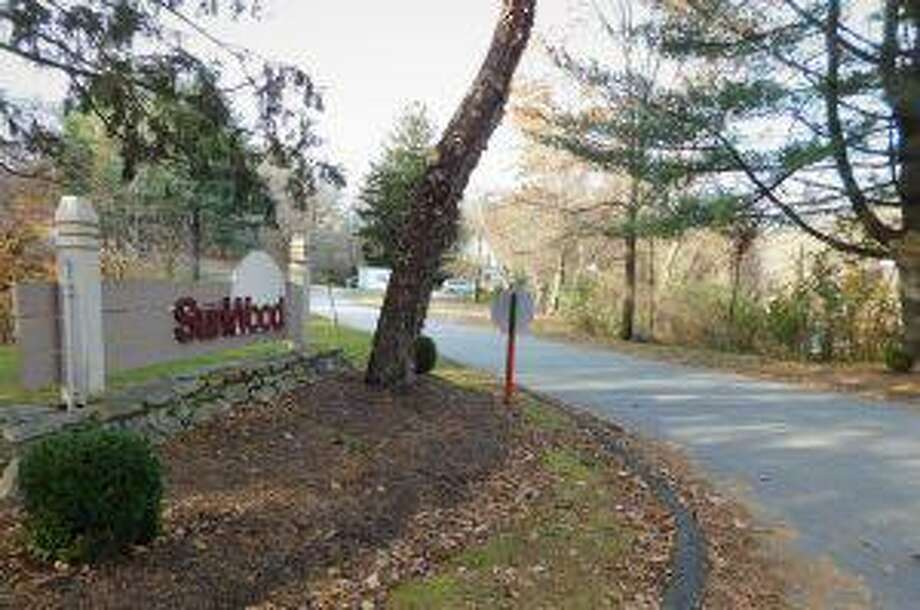 The apartment building would be built on land on the right side of the road, with this photo taken from Old Bridgeport Avenue looking down Sunwood Drive. Photo: Brad Durrell