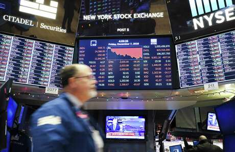 An electronic screen shows the closing numbers on Friday, Dec. 7, 2018 at the New York Stock Exchange in New York. U.S. stocks closed sharply lower on Friday as investors digested a batch of economic data.