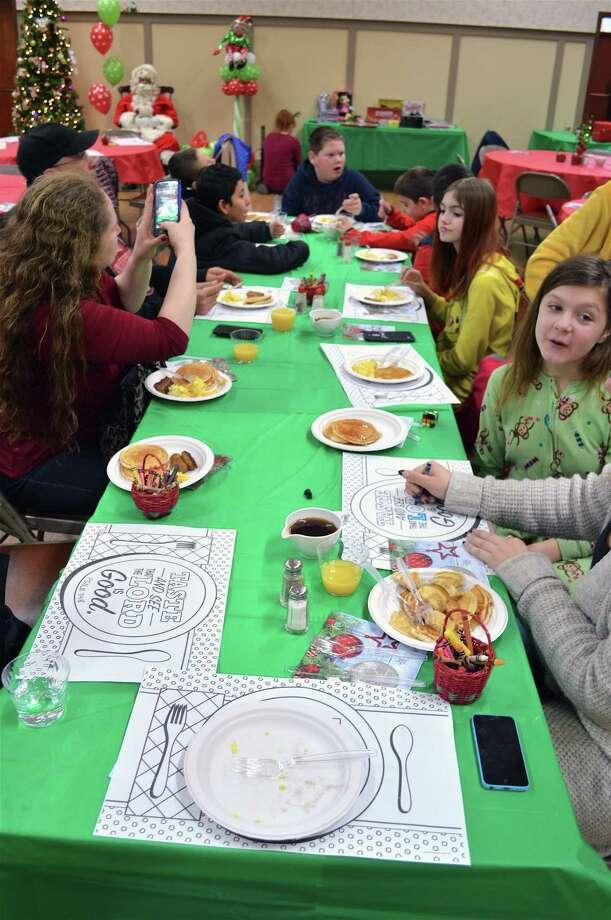 Kids enjoy the annual Breakfast with Santa at Fairfield Grace United Methodist Church, Saturday, Dec. 15, 2018, in Fairfield, Conn. Photo: Jarret Liotta / For Hearst Connecticut Media / Fairfield Citizen News Freelance