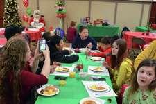 Kids enjoy the annual Breakfast with Santa at Fairfield Grace United Methodist Church, Saturday, Dec. 15, 2018, in Fairfield, Conn.