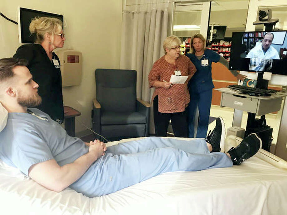 Kyle Ogle (foreground) and AMH staff go through a telemedicine drill. Photo: For The Telegraph
