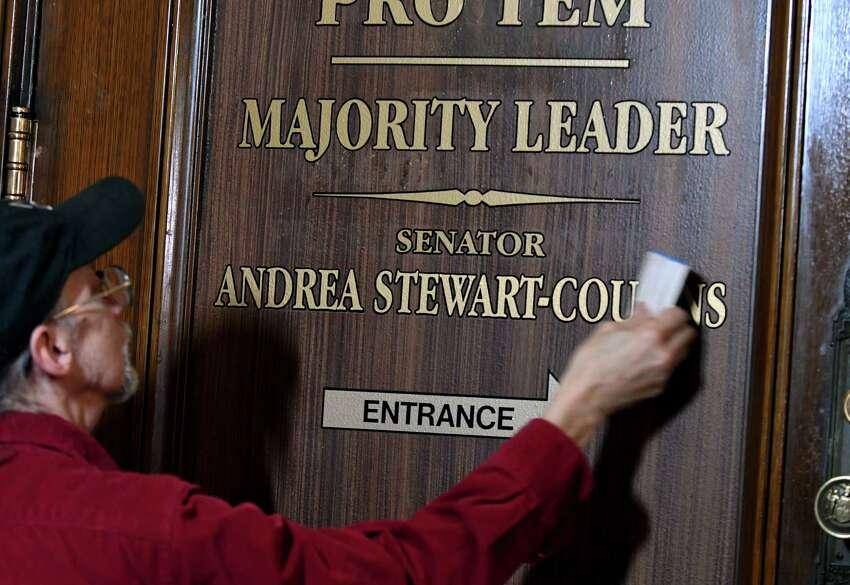 Frank Smith, of Frank Smith Signs, updates signage on the Senate Leader's office door on Monday, Dec. 17, 2018, at the Capitol in Albany, N.Y. Senate Majority Leader Andrea Stewart-Cousins is in the process of moving into the office after Democrats won control of the state senate in November. (Will Waldron/Times Union)