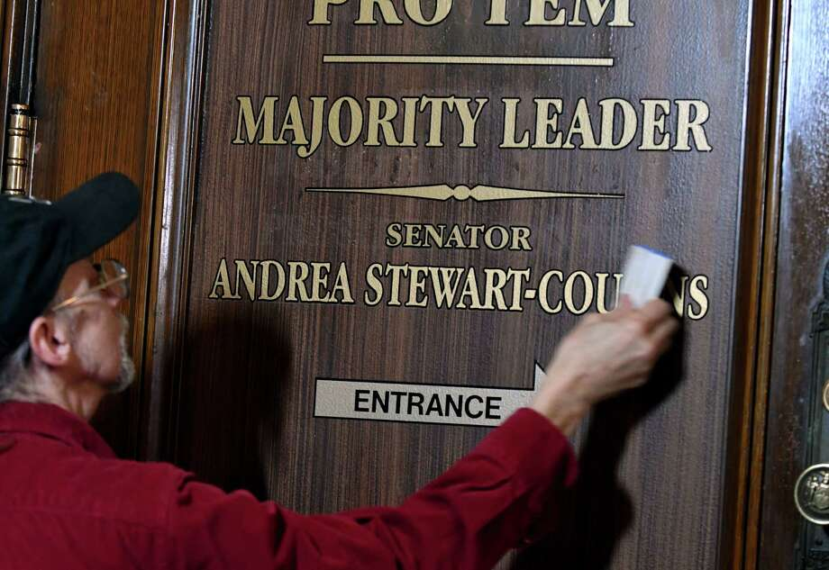 Frank Smith, of Frank Smith Signs, updates signage on the Senate Leader's office door on Monday, Dec. 17, 2018, at the Capitol in Albany, N.Y. Senate Majority Leader Andrea Stewart-Cousins is in the process of moving into the office after Democrats won control of the state senate in November. (Will Waldron/Times Union) Photo: Will Waldron, Albany Times Union