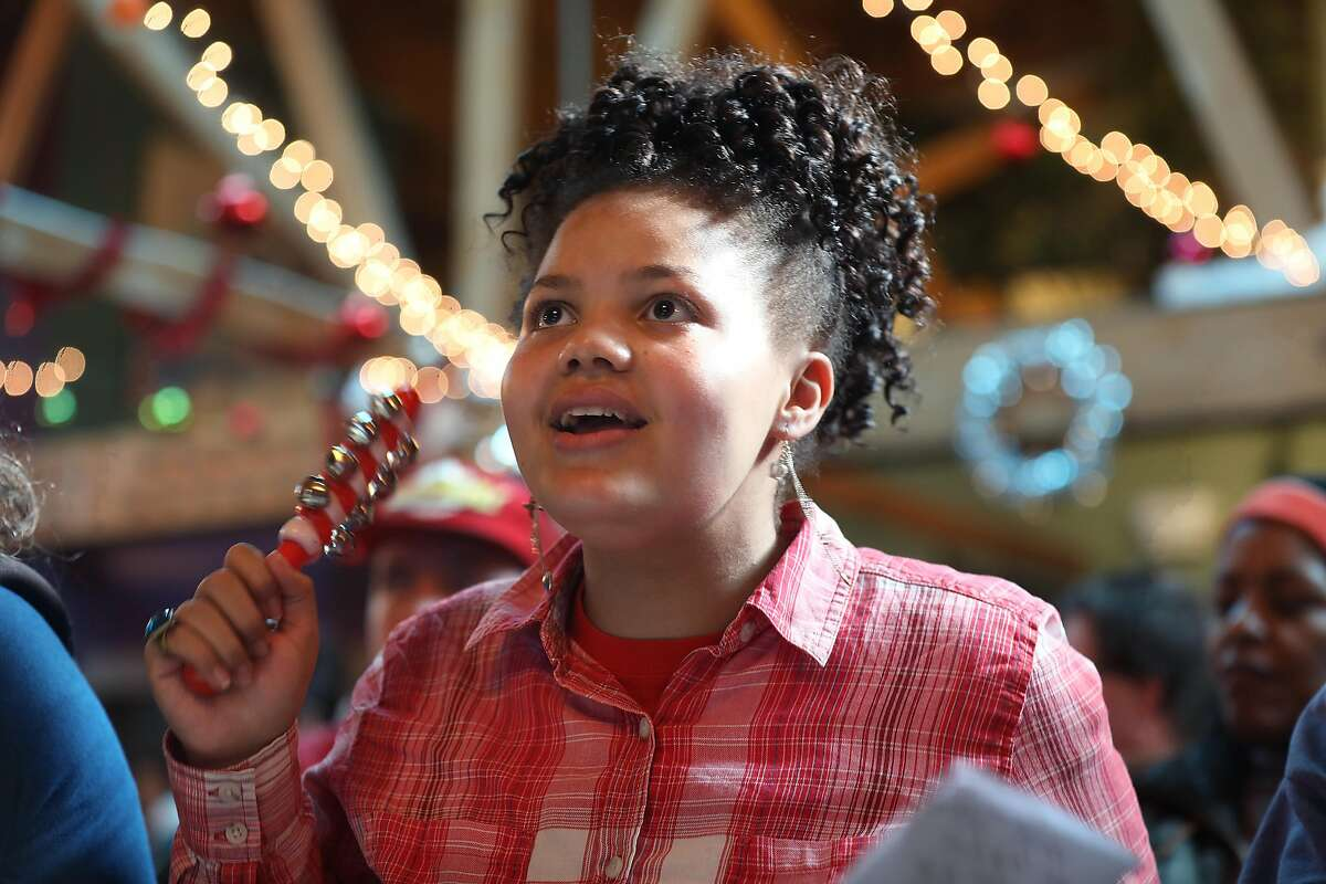 Ayana Norwood sings at the singalong concert at Arc on Monday, Dec. 17, 2018, in San Francisco, Calif. Special education high school and above SFUSD students present holiday singalong concert at Arc.