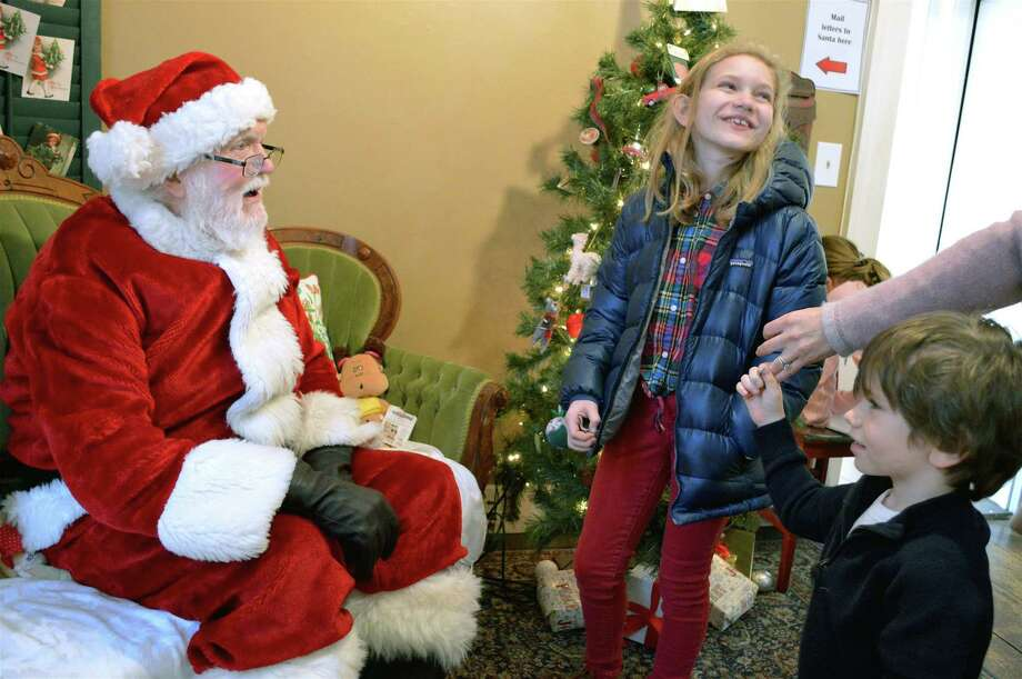 "The Brown children of Westport spend a moment with Santa Claus at the ""Jingle Bell Rock: Family Day with Santa"" at the Westport Historical Society, Saturday, Dec. 15, 2018, in Westport, Conn. Photo: Jarret Liotta / For Hearst Connecticut Media / Westport News Freelance"