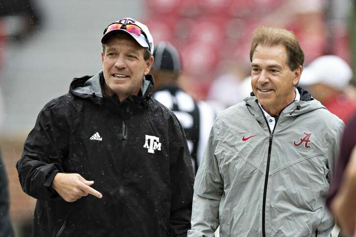 TUSCALOOSA, AL - SEPTEMBER 22:  Head Coach Jimbo Fisher of the Texas A&M Aggies talks at midfield with Head Coach Nick Saban of the Alabama Crimson Tide at Bryant-Denny Stadium on September 22, 2018 in Tuscaloosa, Alabama.  The Crimson Tide defeated the Aggies 45-23.  (Photo by Wesley Hitt/Getty Images)