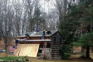 Students from Henry Abbott Technical High School repaired the roof of a disabled Vietnam veteran, helping her stay in her Danbury home.