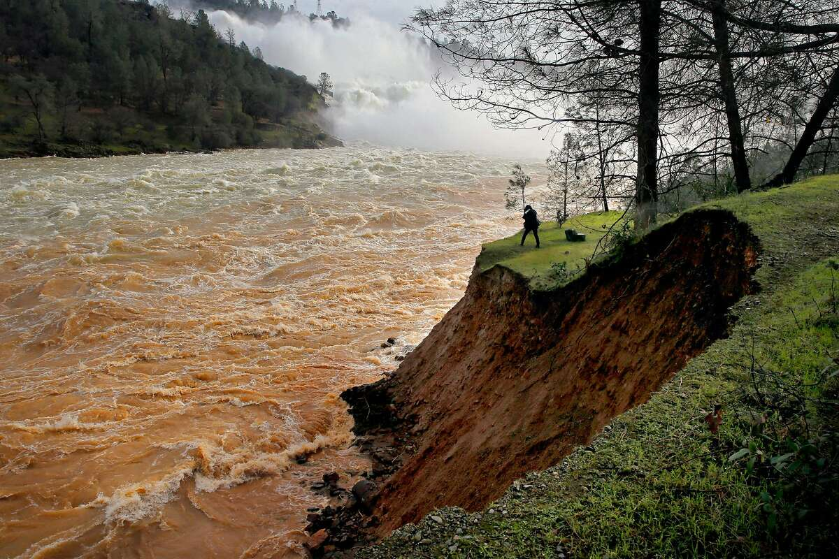 Water is released down the Lake Oroville spillway into the Feather River below on Monday Feb. 13, 2017, in Oroville, Ca.