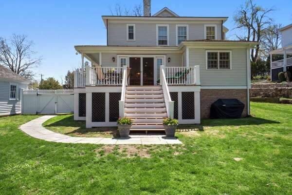 This house sits on a level property of almost one acre and at the rear of the house is a large deck accessed from the eat-in area of the kitchen.