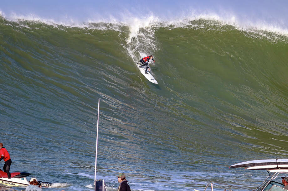 Surfers braved big waves at Mavericks Beach off Half Moon Bay on Dec. 17, 2018. The World Surfing League was eyeing the date last week for the annual surf contest, but decided conditions were too wild and dangerous. Photo: Ben Schutzer / Runamuckphotography.com / ©RunAmuck Photography