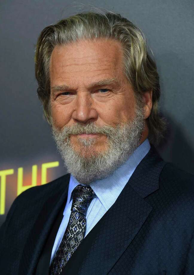 """FILE - In this Sept. 22, 2018 file photo, Jeff Bridges arrives at the Los Angeles premiere of """"Bad Times at the El Royale."""" The Hollywood Foreign Press Association announced Monday that Bridges will be honored with the Cecil B. DeMille Award at the Golden Globe Awards ceremony on Jan. 6, 2019. The actor is known for starring in films including """"Crazy Heart,"""" """"The Big Lebowski,"""" """"True Grit"""" and """"Hell or High Water."""" (Photo by Jordan Strauss/Invision/AP, File) Photo: Jordan Strauss / 2018 Invision"""