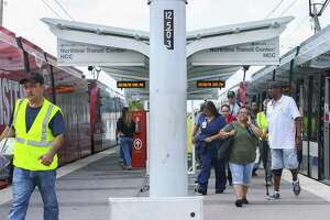 Riders disembark a Metropolitan Transit Authority Red Line light rail train at the HCC Northline Commons station on Fulton near Crosstimbers on July 30. Metro has discussed extending the Red Line at least to Tidwell Road.