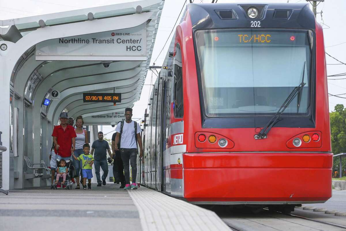 Riders disembark a Metro Red Line light rail train at the HCC Northline Commons station on Fulton Street near E. Crosstimbers Street in Houston on July 30, 2018.
