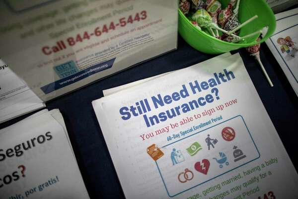 FILE ?- Enrollment counselor Sharon Barker?'s booth at a back-to-school event at the Martha O'Bryan Center in Nashville, Tenn., Aug. 4, 2017. A federal judge in Texas struck down the Affordable Care Act in December 2018, a day before the deadline to sign up for next year?'s coverage in most states, but you might still have time to enroll depending on where you live. (Joe Buglewicz/The New York Times)