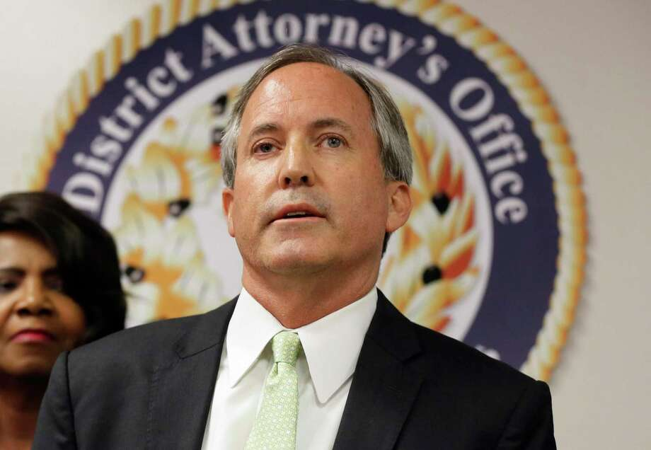 FILE - In this June 22, 2017 file photo, Texas Attorney General Ken Paxton speaks at a news conference in Dallas. Three years ago, criminal charges against Paxton appeared to put his political future in peril. But the Republican enters November's midterm elections favored to win a second a term while remaining under indictment. (AP Photo/Tony Gutierrez, File) Photo: Tony Gutierrez, STF / Associated Press / Copyright 2018 The Associated Press. All rights reserved.