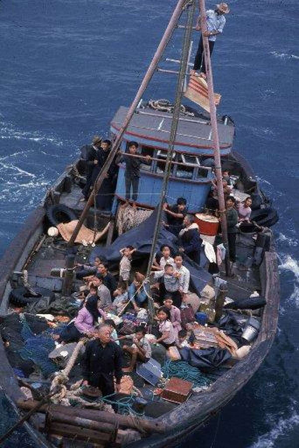 South Vietnamese refugees approach a U.S. war ship to seek refuge from the invading force from the North April 1975 in the South China Sea near Saigon. American involvement in the Vietnam War came to an end when troops from communist North Vietnam invaded Saigon, the capital of the Republic of Vietnam in the South.