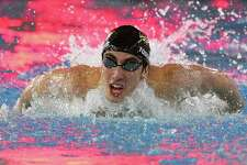 Greenwich's Stephan Todorovic gets first-place in the 100-meter butterfly Monday.
