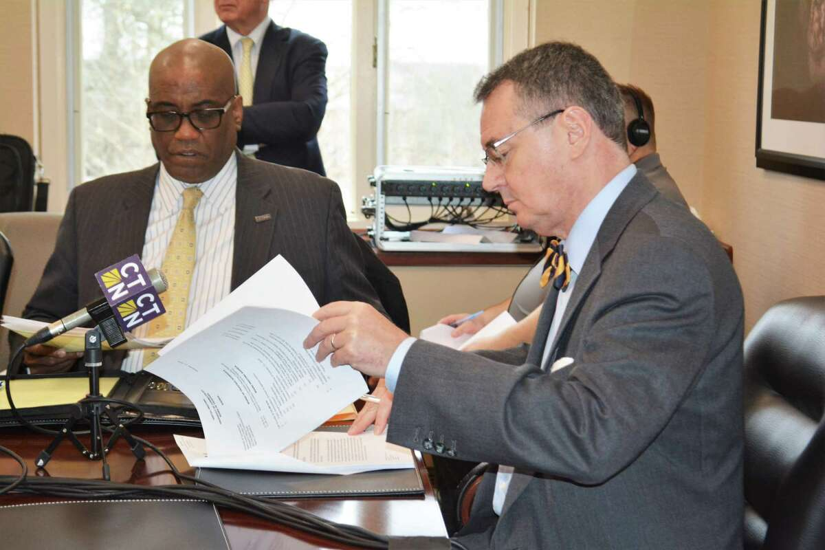 UConn Provost Craig H. Kennedy, right and Lloyd Blanchard, associate vice president of finance at board of director's meeting on sale of Torrington campus Monday, Dec. 17, 2018.