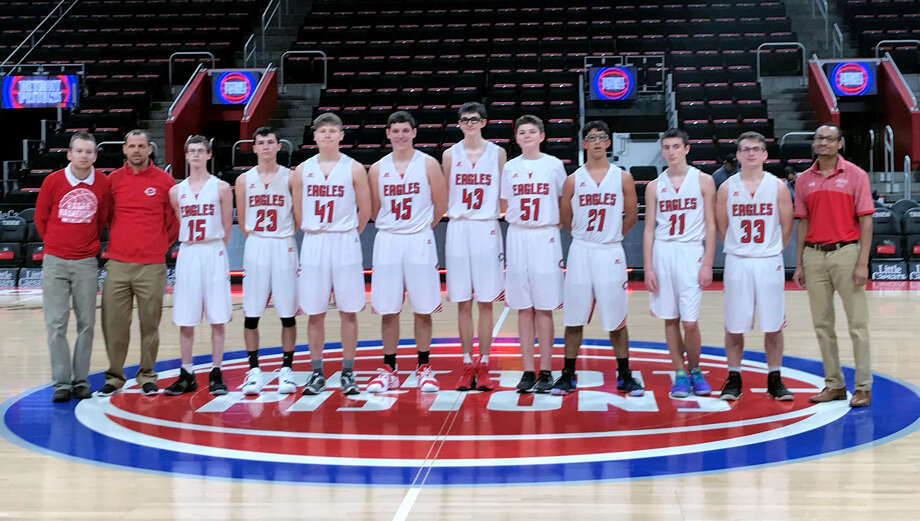 Members of the Caseville varsity basketball team pose for a picture, Saturday, at Little Caesars Arena. (Submitted Photo)