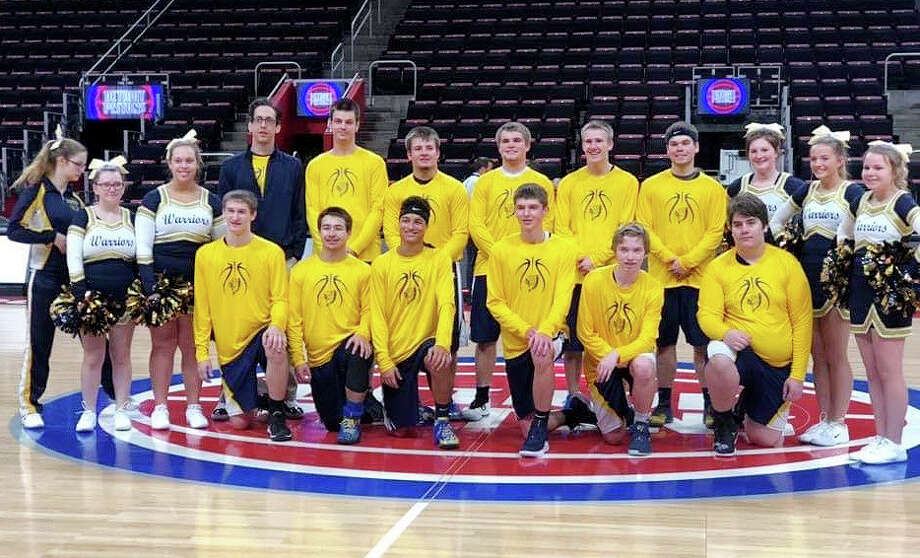 Members of the North Huron varsity basketball team, along with the cheerleaders pose for a picture, Saturday, at Little Caesars Arena. (Submitted Photo)