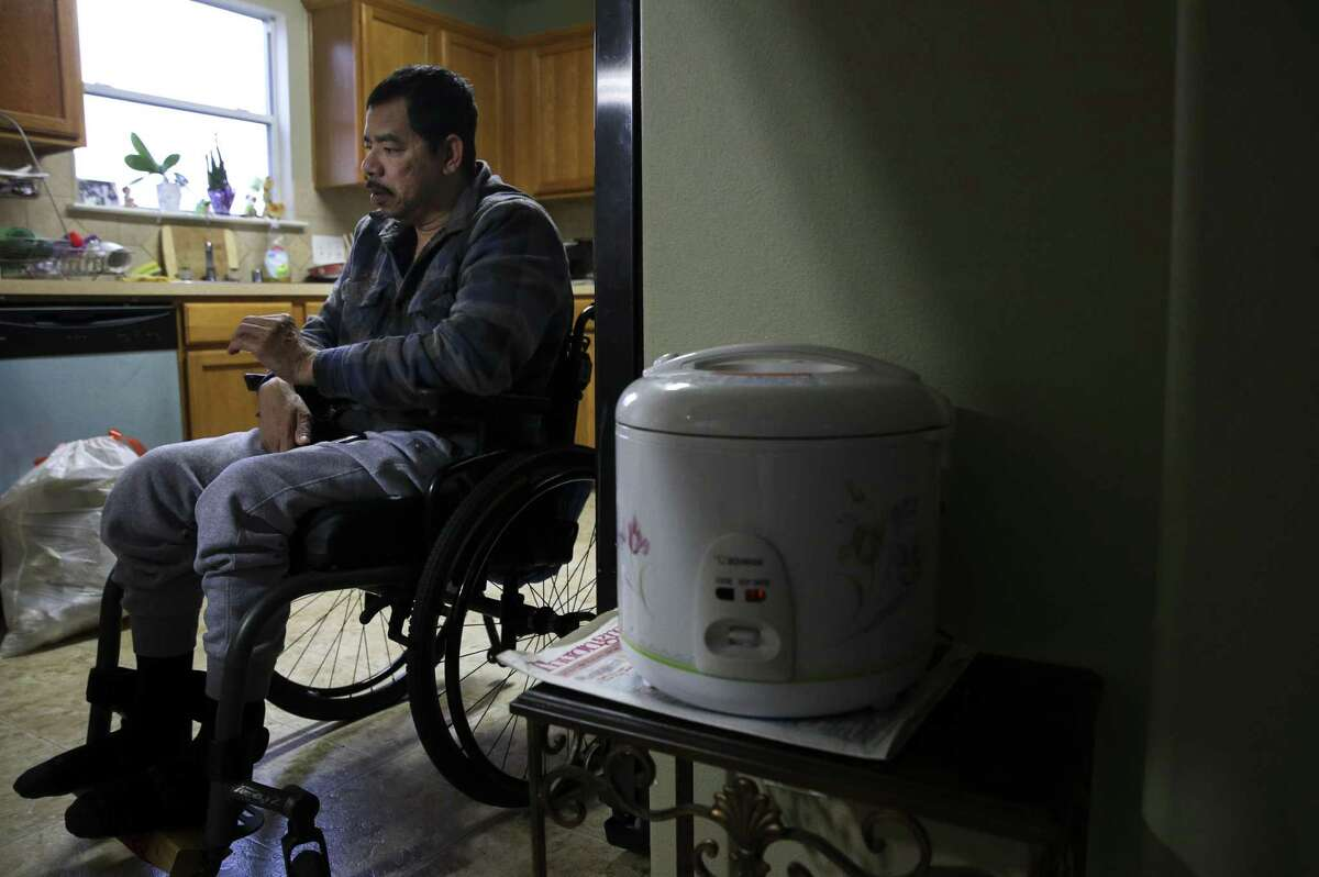 Khanh Hung Le, 47, talks about his situation at his sister's house, where he also lives with his 7-year-old daughter, on Friday, Dec. 14.