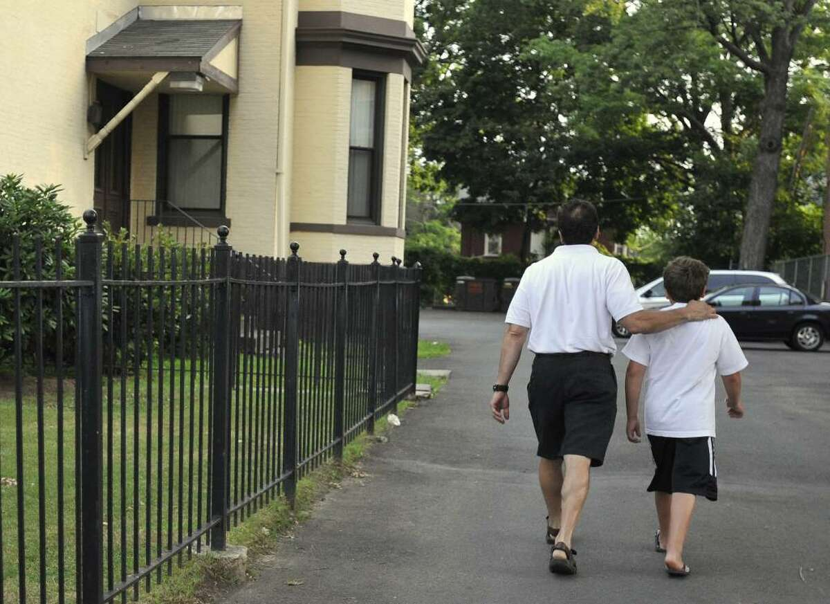 Former Bridgeport Mayor Joseph Ganim, left, with his son Robert, leaves a halfway house in Hartford, Conn., Monday, July 19, 2010. Ganim was sentenced to nine years in prison in 2003 for corruption. (AP Photo/Jessica Hill)