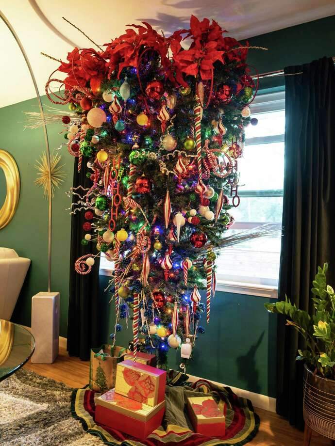 "This is Jon Jimenez's ""Upside Down Tree"" at his home on Monday, December 17, 2018. Jimenez has been decorating trees in his home for the past 22 years he says, and adds that many of trees bear ornaments either given to him by or reminding him of friends and family. Photo: Matthew Busch, Freelance Photographer / Matthew Busch / San Antonio Express-News"