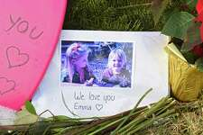 A small memorial is seen on the lawn of the house on Adams Circle where Steven Jones shot his wife, Jennifer, and 12-year-old daughter, Emma, before shooting himself last week on Monday, Dec. 17, 2018 in Ballston Spa, N.Y. (Lori Van Buren/Times Union)