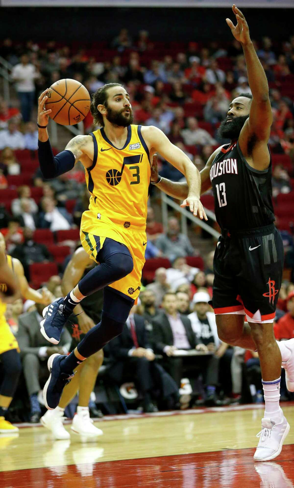 Utah Jazz guard Ricky Rubio (3) looks to pass the ball over Houston Rockets guard James Harden (13) during the first half of an NBA game at Toyota Center, Monday, Dec. 17, 2018, in Houston.