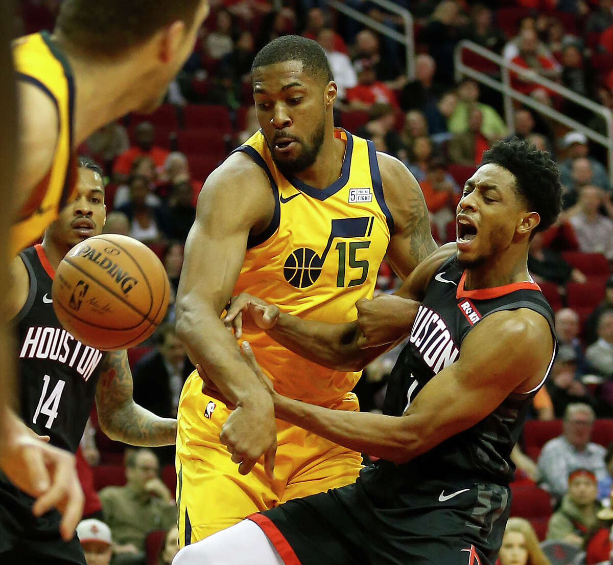 Houston Rockets guard Brandon Knight (2) battles against Utah Jazz forward Derrick Favors (15) during the first half of an NBA game at Toyota Center, Monday, Dec. 17, 2018, in Houston.