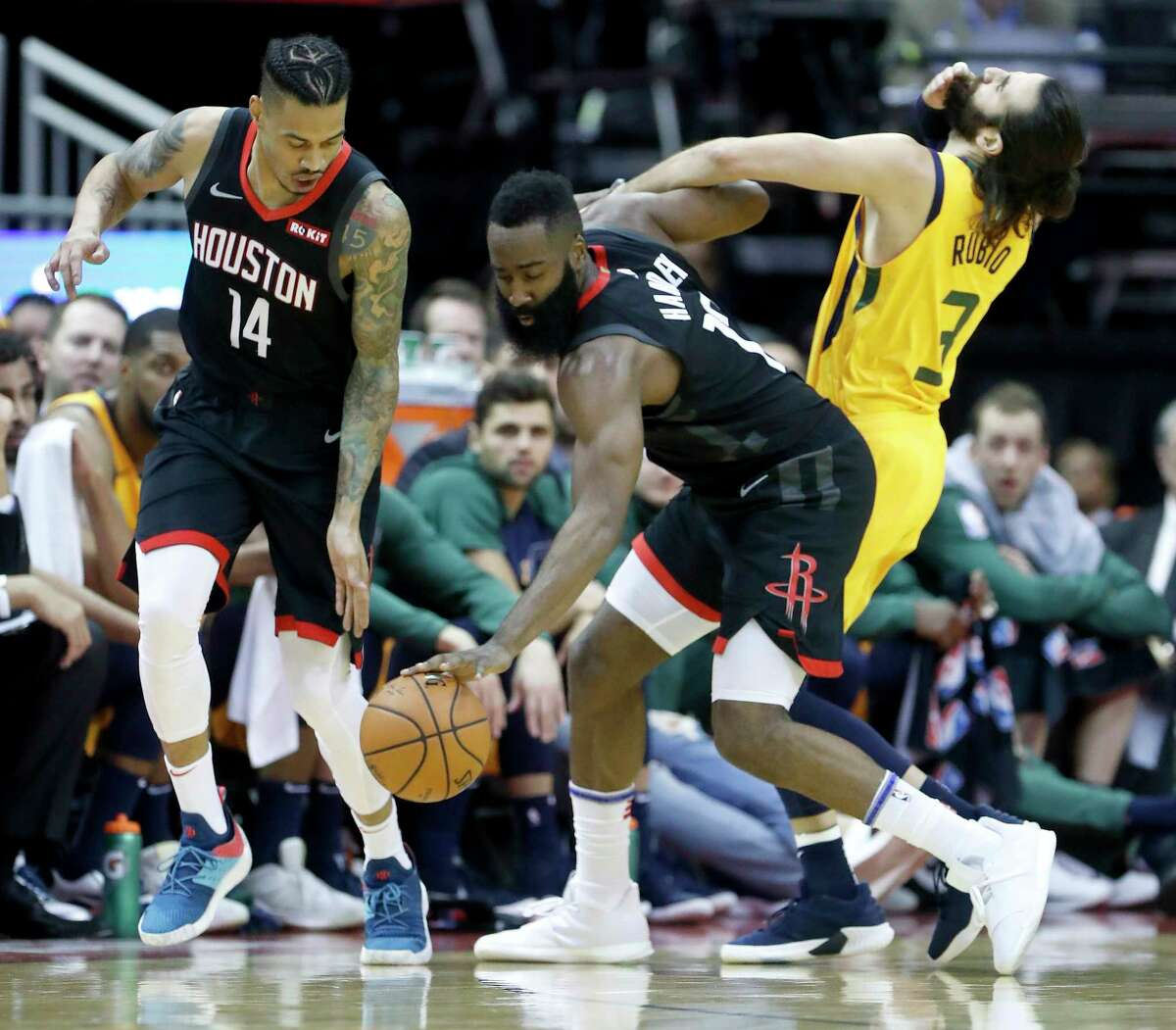 Houston Rockets guards James Harden (13) and Gerald Green (14) reach for a ball against Utah Jazz guard Ricky Rubio (3) during the first half of an NBA game at Toyota Center, Monday, Dec. 17, 2018, in Houston.