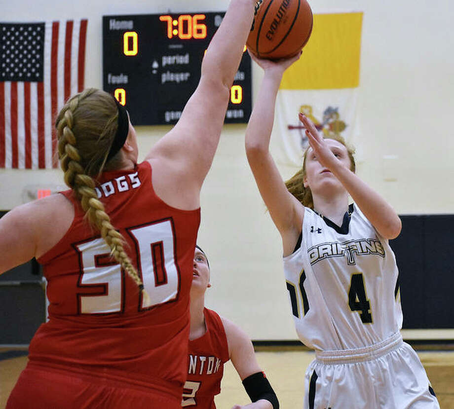 FMCHS guard Anna McKee, right, goes up for a runner in the lane during the first quarter against Staunton on Monday in Glen Carbon. Photo: Matt Kamp/Intelligencer