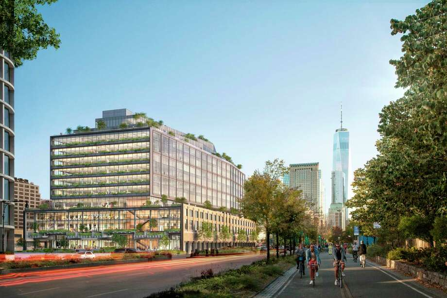 This artist rendering provided by COOKFOX architects shows a building conceived by COOKFOX architects at 550 Washington Street to house an expansion by Google on Manhattan's west side at the site of the former St. John's Terminal. It's part of a new office complex Google said Monday, Dec. 17, 2018, it was spending more than $1 billion to build, allowing the internet search giant to double the number of people it employs there. (Oxford Properties/COOKFOX Architects via AP) / COOKFOX architects