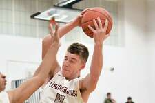 Lansingburgh's Vinny Tario grabs a rebound during a basketball game against Mohonasen on Monday, Dec. 17, 2018 in Troy, N.Y. (Lori Van Buren/Times Union)