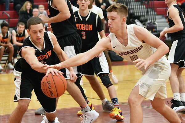 Mohonasen's Nicholas Richmond, left, and Lansingburgh's Vinny Tario battle for a loose rebound during a basketball game on Monday, Dec. 17, 2018 in Troy, N.Y. (Lori Van Buren/Times Union)