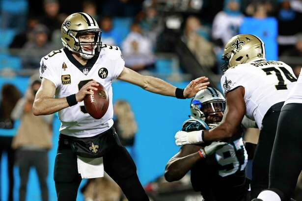 New Orleans Saints' Drew Brees (9) scrambles against the Carolina Panthers in the first half of an NFL football game in Charlotte, N.C., Monday, Dec. 17, 2018.