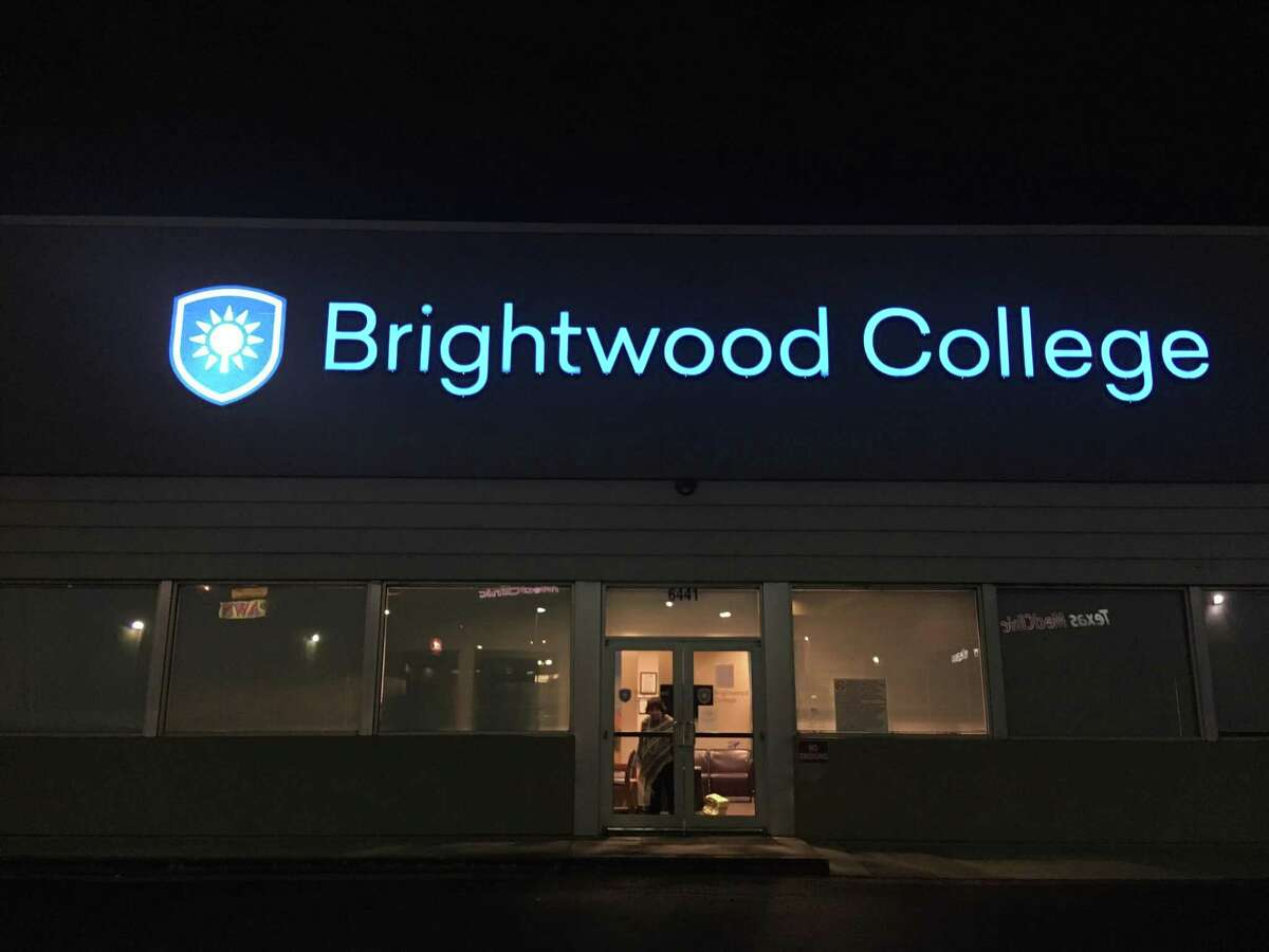 A sign on the door of Brightwood College's campus near Ingram Park Mall told students on Dec. 5 no classes would be held there after that week. The for-profit school taught in a variety of medical and health fields. Its parent corporation closed more than 75 schools in 18 states.