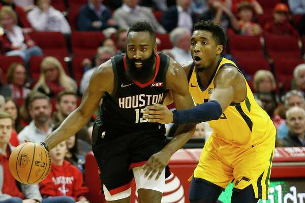 Houston Rockets guard James Harden (13) drives the ball against Utah Jazz guard Donovan Mitchell (45) during the second half of an NBA game at Toyota Center, Monday, Dec. 17, 2018, in Houston.