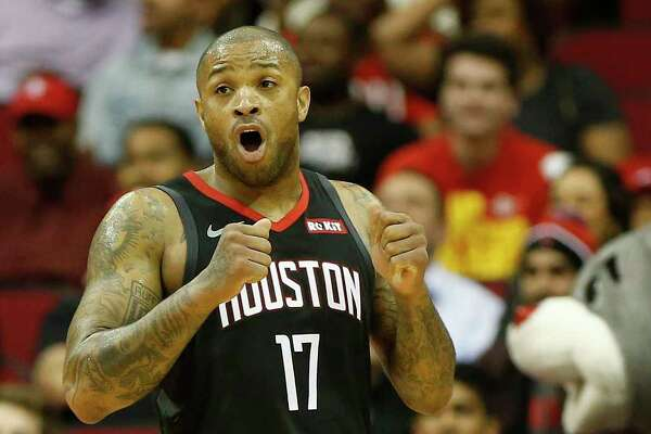Houston Rockets forward PJ Tucker (17) reacts after a foul was called on Eric Gordon (10) during the second half of an NBA game at Toyota Center, Monday, Dec. 17, 2018, in Houston.