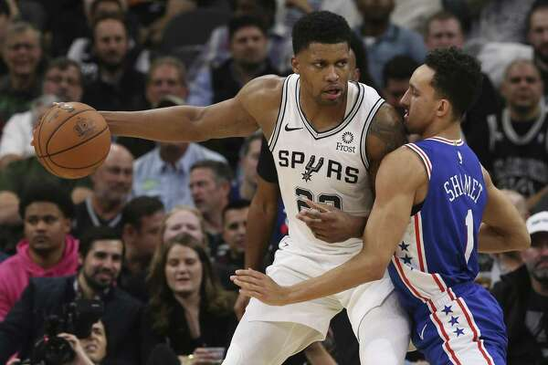 San Antonio Spurs?' Rudy Gay keeps the ball away from Philadelphia 76ers?' Landry Shamet during the second half at the AT&T Center, Monday, Dec. 17, 2018.