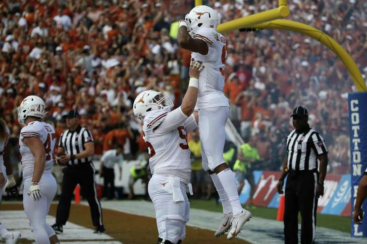 Texas receiver Collin Johnson, right, and center Zach Shackelford celebrate a touchdown against Oklahoma in October. Johnson can look forward to going up against one of the best cornerbacks in the nation in Georgia's Deandre Baker in the Sugar Bowl.