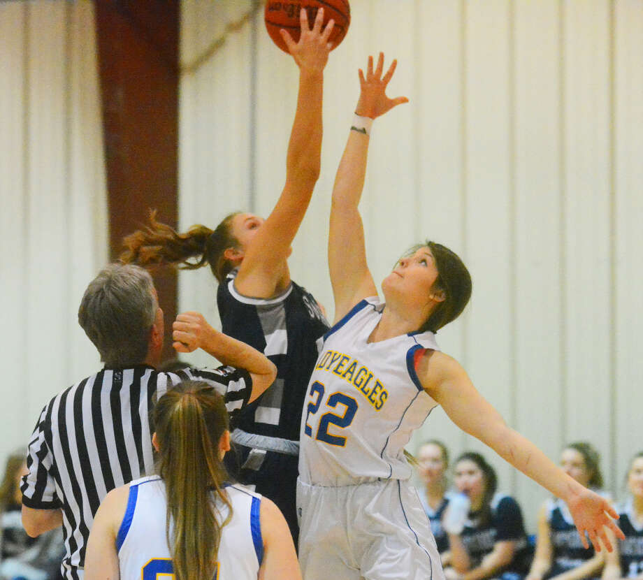 Plainview Christian Academy's Alanna Tibbets goes up for the tip-off against Southcrest Lady Warrior Mackenzie Garrison during girls basketball action on Monday in Plainview. Photo: Alexis Cubit/Plainview Herald