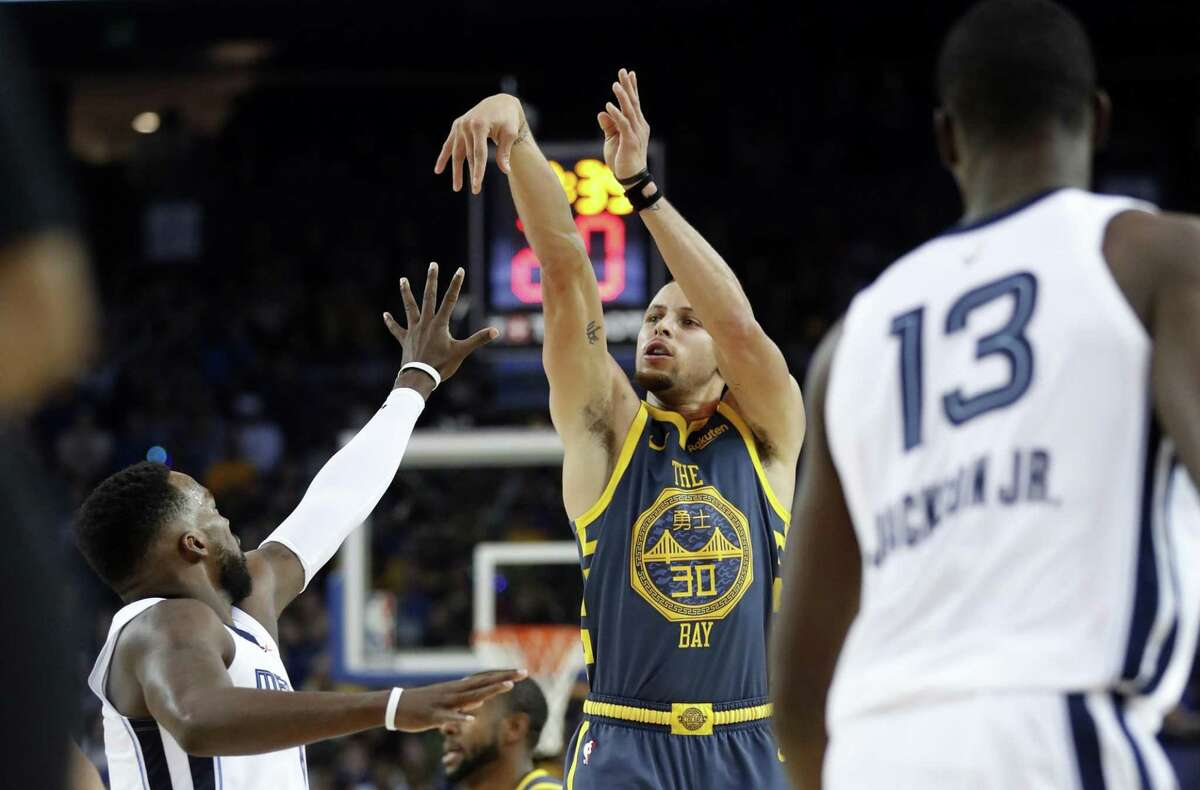 Golden State Warriors' Stephen Curry score his 15,000th career point on a 3-pointer in 2nd quarter against Memphis Grizzlies during NBA game at Oracle Arena in Oakland, Calif. on Monday, December 17, 2018.