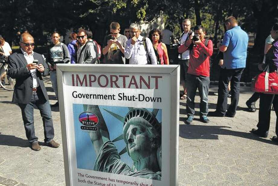 People look at a sign informing them that the Statue of Liberty is closed due to the government shutdown in Battery Park in 2013. A similar partial shutdown could occur Friday if President Donald Trump he doesn't get $5 billion for a southern border wall. Photo: Getty Images