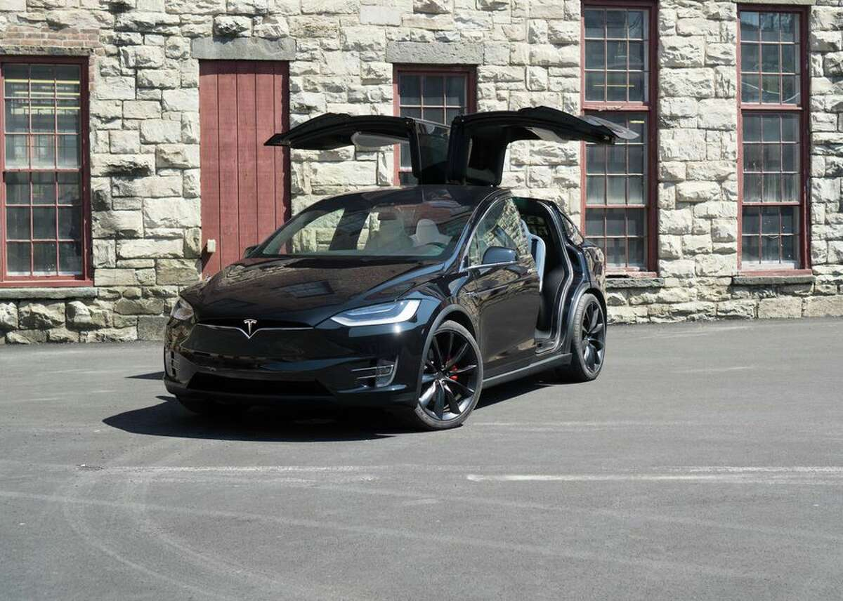 A Model X with the gull-wing doors open.
