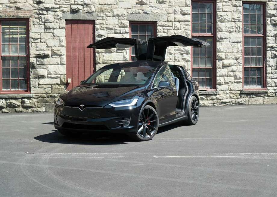 A Model X with the gull-wing doors open. Photo: CBSI/CNET