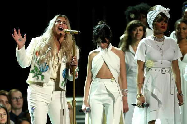 "FILE - In this Jan. 28, 2018 file photo, Kesha, left, performs ""Praying"" as Camila Cabello, center, and Andra Day stand by at the 60th annual Grammy Awards at Madison Square Garden in New York. (Photo by Matt Sayles/Invision/AP, File)"